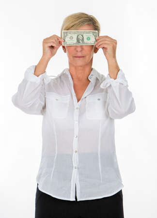 manager woman holding banknote covering her eyes