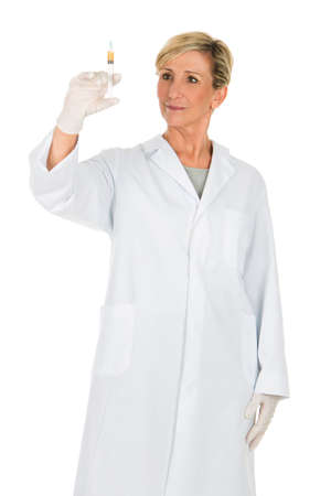 short gloves: middle age woman doctor with syringe Stock Photo