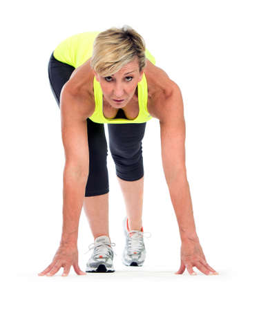 fitness middle age woman in a start position