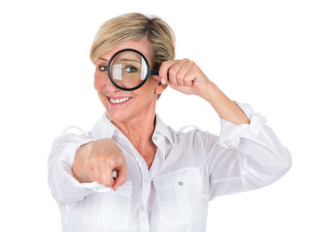looking through: manager woman looking through magnifying glass