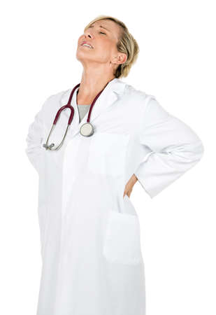 50 to 55 years: woman doctor with back pain Stock Photo