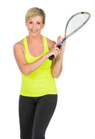 50 to 55 years: middle aged woman holding squash racket