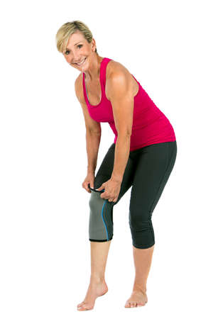 age 50 55 years: middle age woman with patellar knee brace