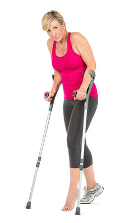 45 to 50 years old: fitness woman walking with crutches