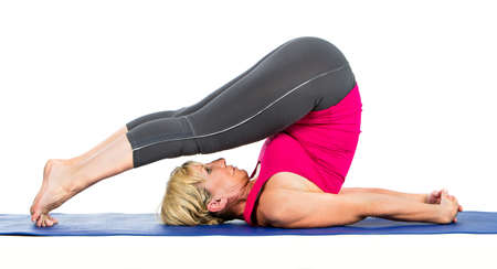 45 to 50 years old: middle age woman doing yoga exercises