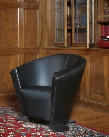 Armchair library with wood wall Stock Photo