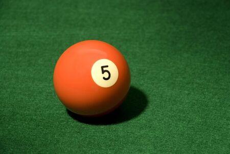 Pool Ball 5 on green velvet Stock Photo