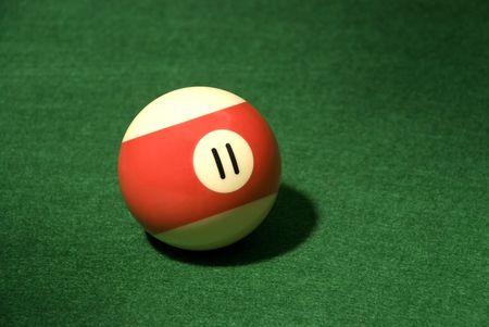 Pool Ball 11 on green velvet Stock Photo