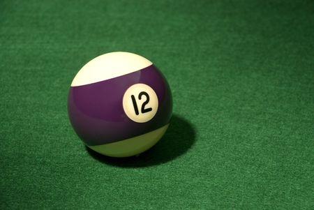 Pool Ball 12 on green velvet