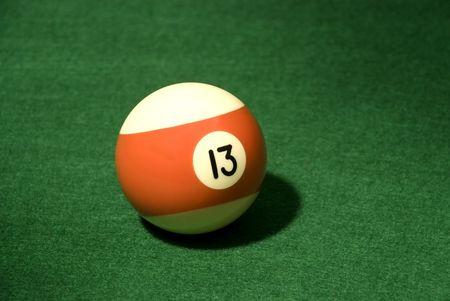 Pool Ball 132 on green velvet photo