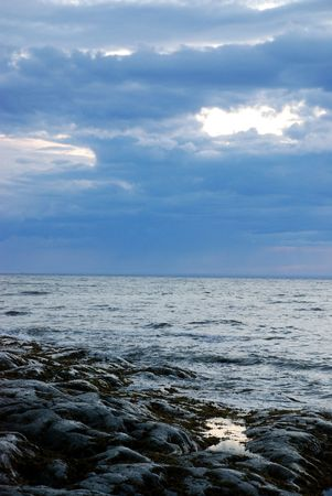 Rock and sea with dramatic sky
