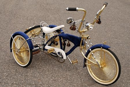 road bike: Bicycle has three wheels modified with gold and silver