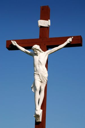 Statue of redeemer Jesus Christ on wood cross Stock Photo