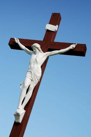sinners: Statue of redeemer Jesus Christ on wood cross Stock Photo