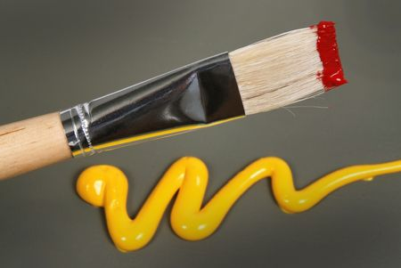 Wood painting brush over abstract colored background