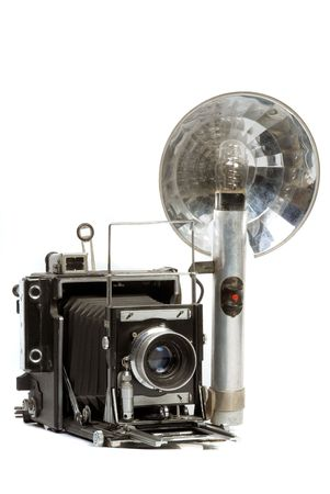 old photo: Old  Photo camera with bulb flash