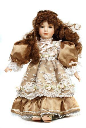 Portret van retro porseleinen pop met vetersluiting jurk