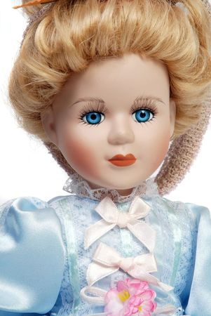 Portrait of retro porcelain doll face with blue dress
