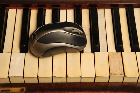 Vintage old Piano and modern computer mouse
