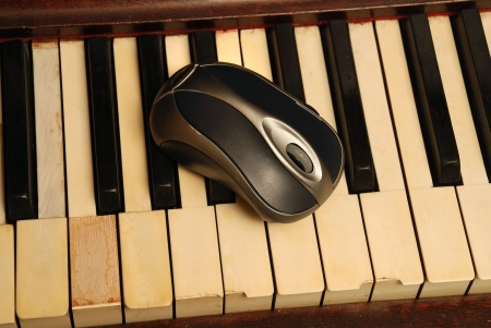 Vintage old Piano and modern computer mouse photo