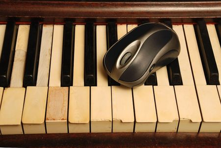 Vintage old Piano and modern computer mouse Stock Photo - 5116651