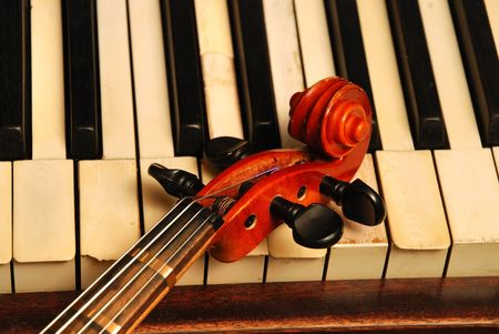 violins: Vintage old Piano and violin head part Stock Photo