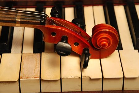 violin player: Vintage old Piano and violin head part Stock Photo
