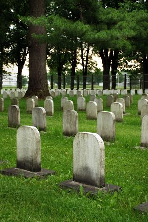 Old white tombstones in a canadian christian catholic cemetery.