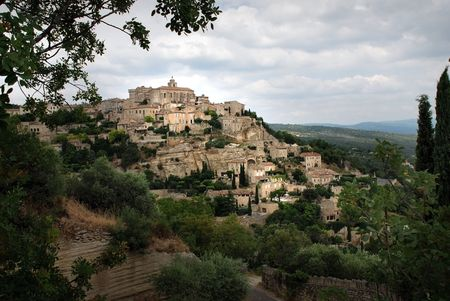 Village of Gordes in the dramatic cloudy lighting photo