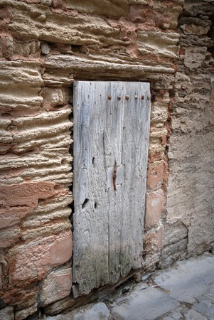 Old medieval entrance door with wooden door photo