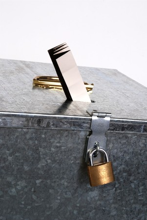 aluminum foil: Vintage metal ballot box with padlock ticket voting Stock Photo