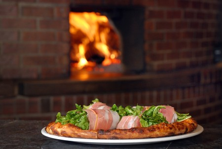 ingredient: Pizza with roll of italian ham fresh out of a wood burning oven