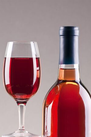 Glass and bottle of rose wine  with gray background Stock Photo - 8543482