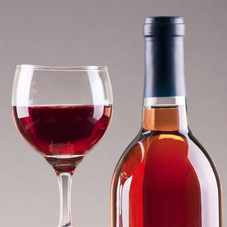 Glass and bottle of rose wine  with gray background Stock Photo - 8543481