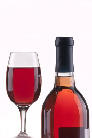 Glass and bottle of rose wine  with white background Stock Photo - 8543480