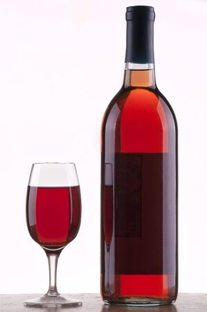 Glass and bottle of rose wine  with  white background Stock Photo - 8543478