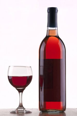Glass and bottle of rose wine  with  white background Standard-Bild