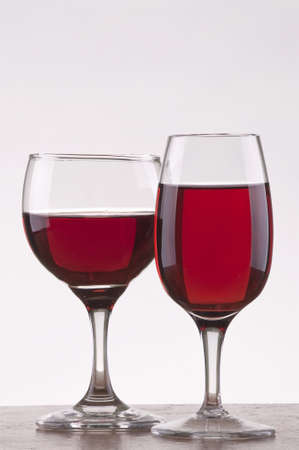 Two different glass of rose wine  with gray background Stock Photo - 8543476