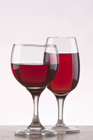 Two different glass of rose wine  with gray background