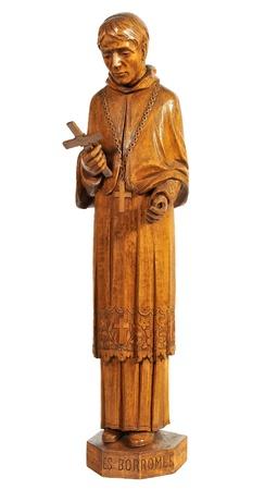 catholicism: religious wood figurine of Saint Charles Borromée isolated on white background Stock Photo