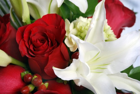 bunch of flowers, red roses and white lys Stock Photo