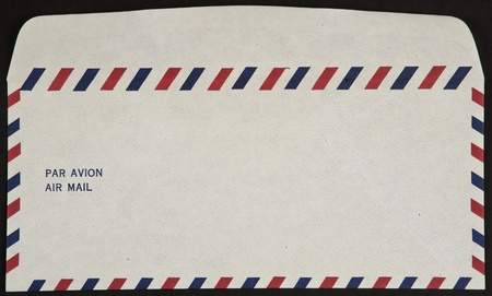 avion: air mail envelope isolated on black background par avion Stock Photo