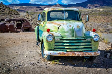 Old rusty and abandoned car in the Arizona desert USA