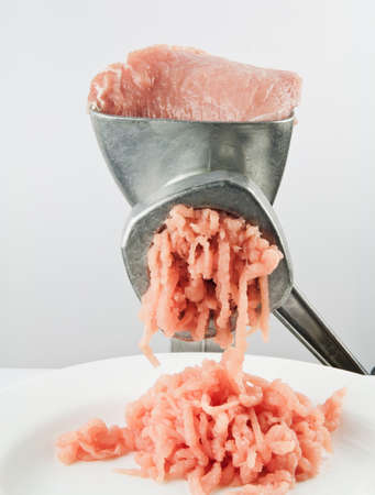 minced meat: Vintage meat grinder with mince