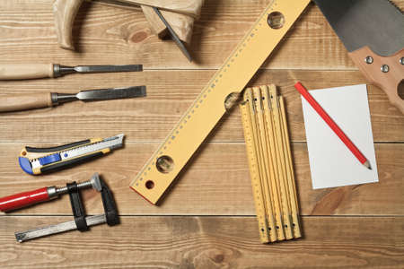Set of different tools on a wooden planks Stock Photo