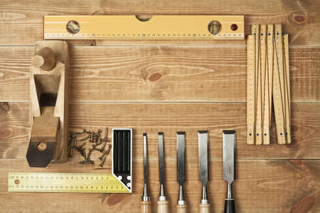 Set of different tools on a wooden planks photo