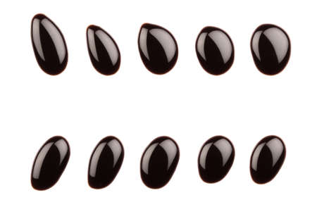 Chocolate syrup drops on white background