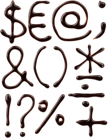 Symbols set written with chocolate syrup photo
