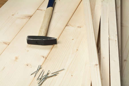 carpenter with a measuring tool and a pencil photo