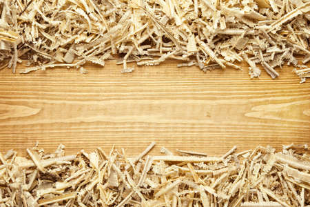 Wooden sawdust and shavings background with space for text Stock Photo